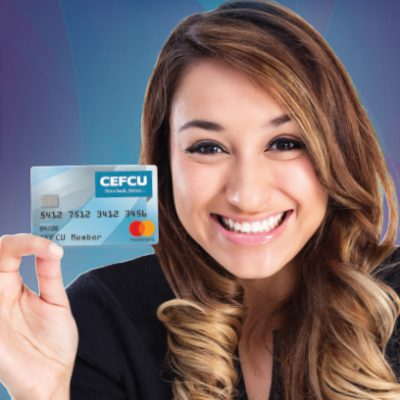 Smiling woman hold CEFCU credit card