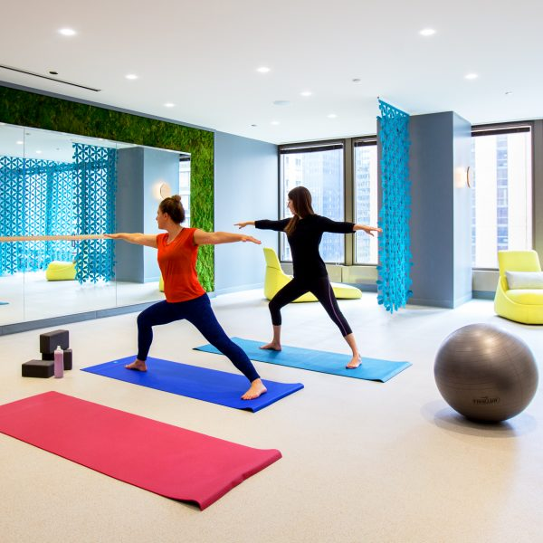 Image of two people doing yoga in the KSM gym.