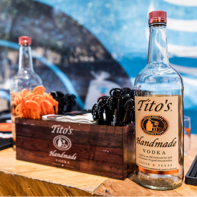 Tito's Vodka and branded wood crate on bar top