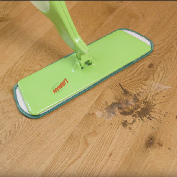 Libman mop cleaning up spill on hardwood floor
